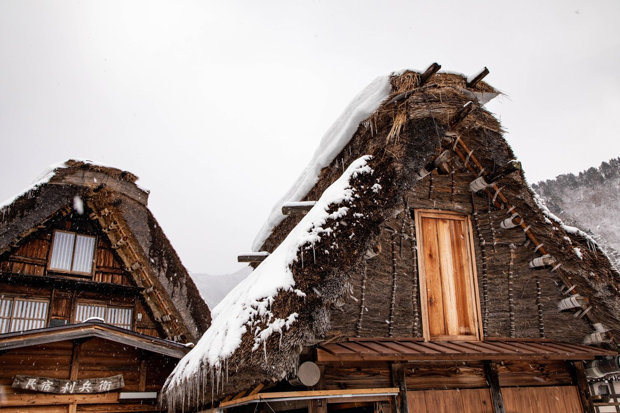Traditional Japanese roof or gassho zukuri in winter, covered with snow.