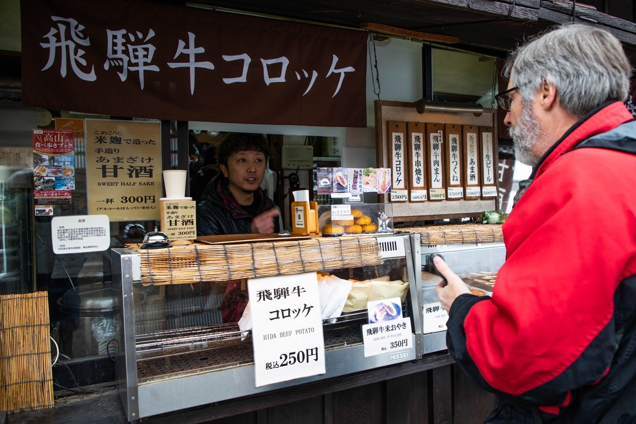 Jim ordering the famous Hida beef and potato croquette
