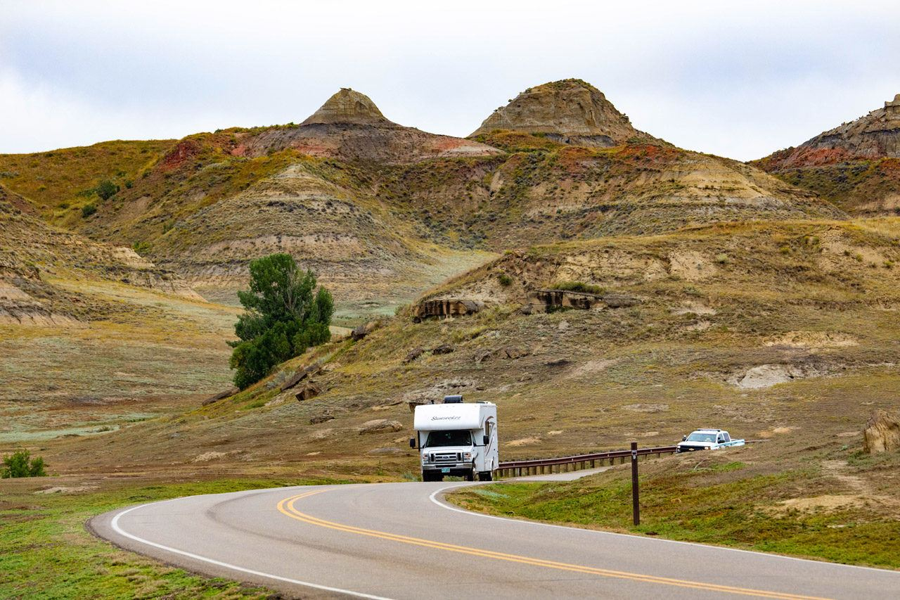 Camper driving through the North Dakota Badlands…one thing to put on your North Dakota bucket list.
