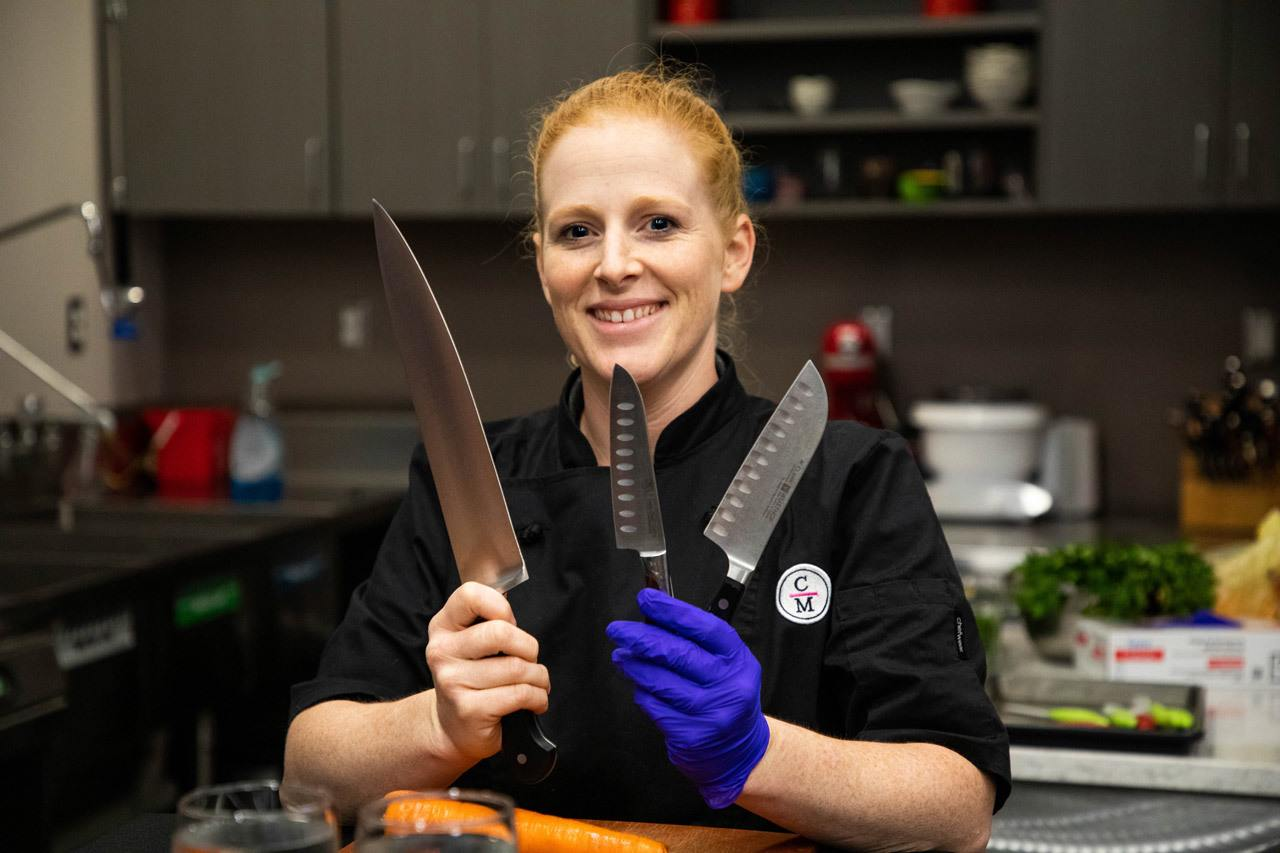 The chef at Cooks on Main brandishes three knives. Activities like this chopping lesson is one reason to visit North Dakota.