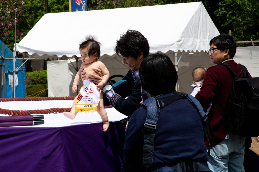 This cute little baby is ready to take on a sumo wrestler at the baby crying event in Tokyo.