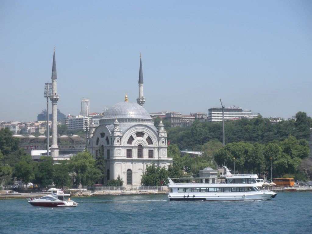 Dolmabahce Palace from the water. Boats are in front of it.