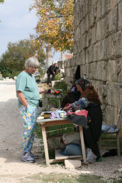 Vendors sell handmade goods outside the Temple of Zeus.