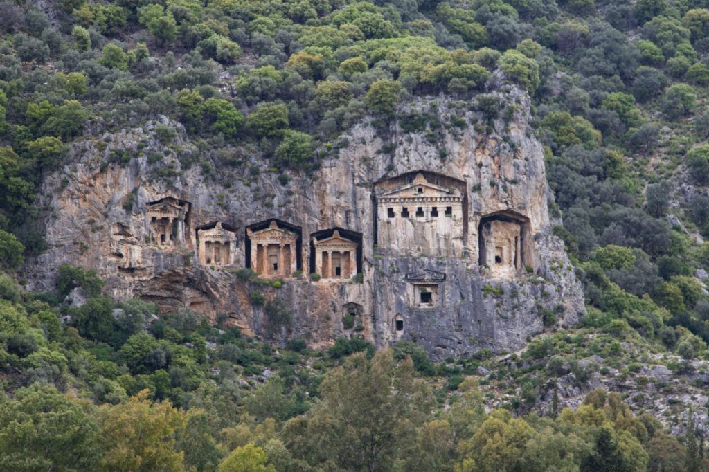 Lycian rock tombs are cut in the cliff face near Demre, Turkey.