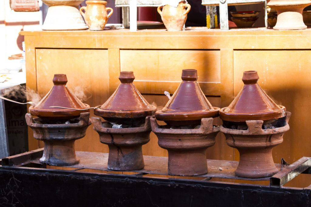 Tajines with Typical Moroccan meals steam along the street in Marrakesh.