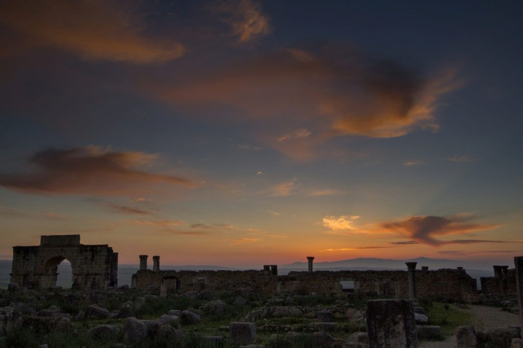 Sun setting on the Roman ruins in Volubilis, Morocco.